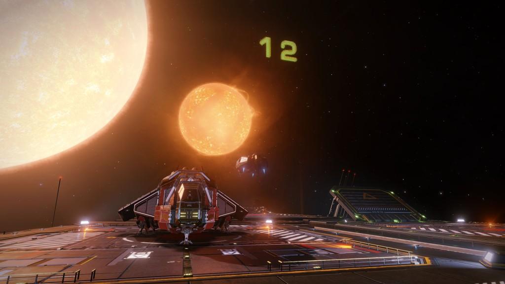 Elite: Dangerous beginner's guide: a screenshot of ships landing on a fleet carrier
